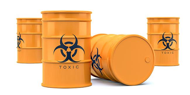 Yellow biohazard toxic waste barrels isolated on white backgroun